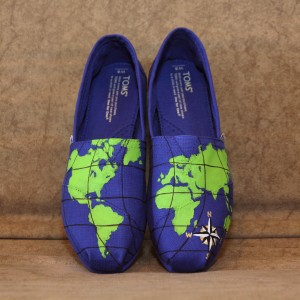 Custom, hand painted World Map TOMs shoes featuring a map of the world with a gold, black, and white compass.