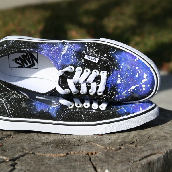 Custom, hand painted Galaxy Vans lace up shoes featuring a galaxy night sky pattern with white and glow in the dark stars.