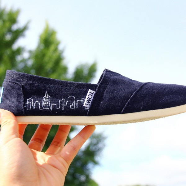 Custom, hand painted City Skyline TOMS shoes featuring a vector line art of a city skyline.