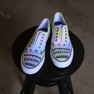 Custom, hand painted Tie Dye Geometric lace up shoes featuring a tie dye color background with a geometric pattern overlay in black.