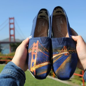 Custom, hand painted Golden Gate Bridge TOMS featuring the Golden Gate Bridge in San Francisco, California at night. Displayed in front of the actual Golden Gate Bridge in SF, CA.