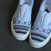 Custom, hand painted Tie Dye Geometric lace up shoes featuring a blue and purple tie dye color background with a geometric pattern overlay in black.