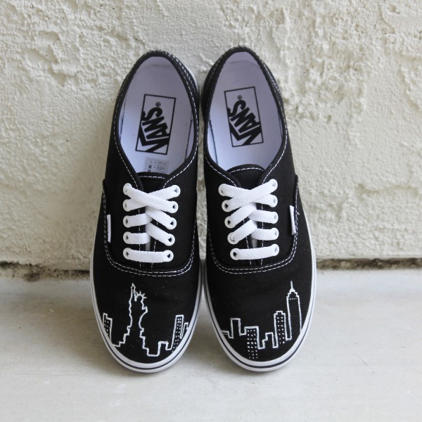 Custom, hand painted New York City Skyline Vans featuring the Statue of Liberty, the Empire State Building, and other building silhouettes visible in the NYC Skyline.