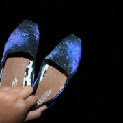 Custom, hand painted Galaxy TOMS shoes featuring a galaxy night sky pattern with white and glow in the dark stars.