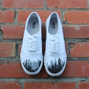 Custom, hand painted London Skyline Vans featuring the London Eye, the Big Ben, and other building silhouettes visible in the London Skyline.