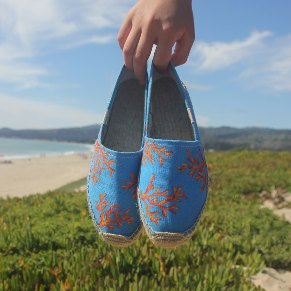 Custom, hand painted Coral pattern Soludos espadrilles shoes. Displayed at the beach.