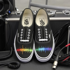 Custom, hand painted Audio wave Vans shoes featuring a rainbow spectrum of the audio wave. Displayed in front of audio equipment and cords.
