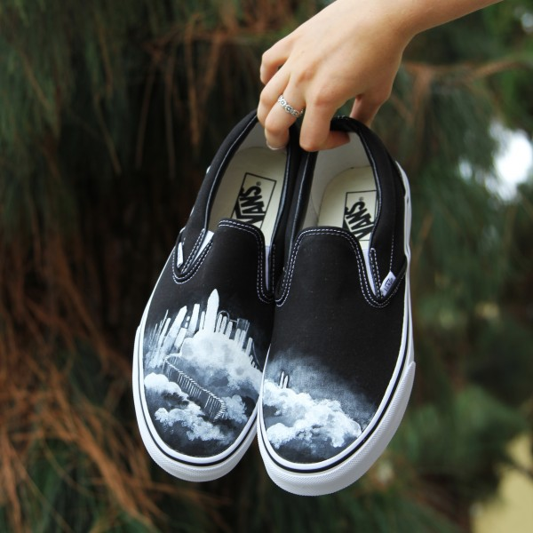 Custom, hand painted Cloud Castle Vans shoes featuring a mystical castle sitting amidst white clouds with a staircase leading down.